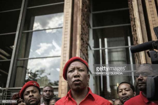 South African President of the Economic Freedom Fighters Julius Malema talks to the press as he leaves the constitutional court after filling an...
