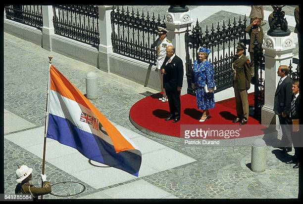 South African President Pieter Willem Botha and his wife Elize stand in front of the Parliament building in Cape Town during the 1987 state opening...