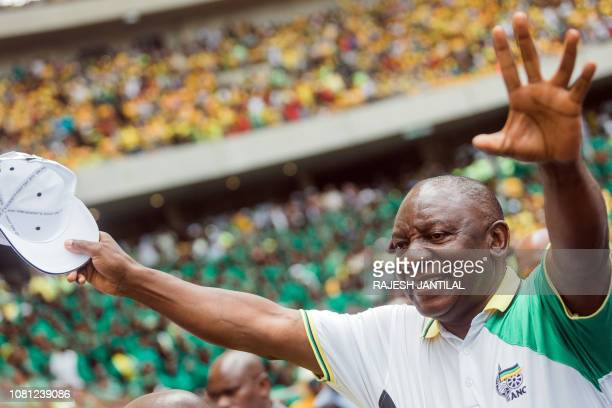 South African President President Cyril Ramaphosa greets supporters as he arrives at the African National Congress 107th anniversary celebrations at...