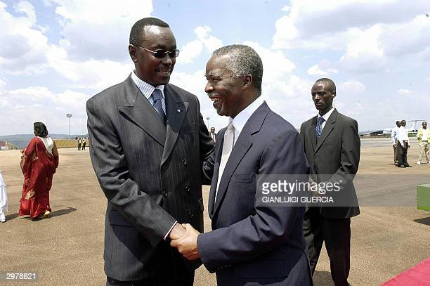 South African President Thabo Mbeki is welcomed by Rwanda Prime Minister Bernard Makuza upon his arrival at at Kigali International Airport 13...