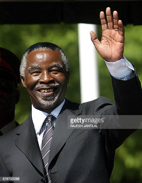 South African President Thabo Mbeki waves to supporters after being sworn in as president for a second term during the saluting of the guard of...