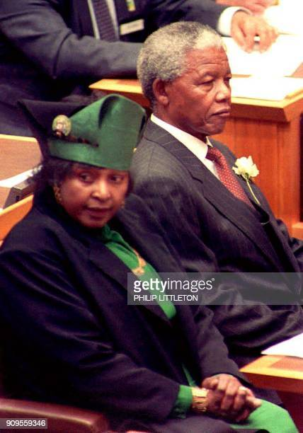 South African Presidentelect Nelson Mandela sits next to his estranged wife Winnie for a brief moment during the inaugural sitting of South Africa's...