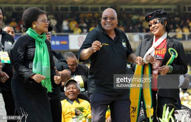 South African Presidential favourite Jacob Zuma dances with antiapartheid campaigner Winnie Mandela former wife of South African President Nelson...