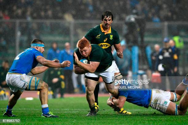 South African prop Steven Kitshoff is tackled by Italian flanker Giovanni Licata during a Rugby union test match between Italy and South Africa at...