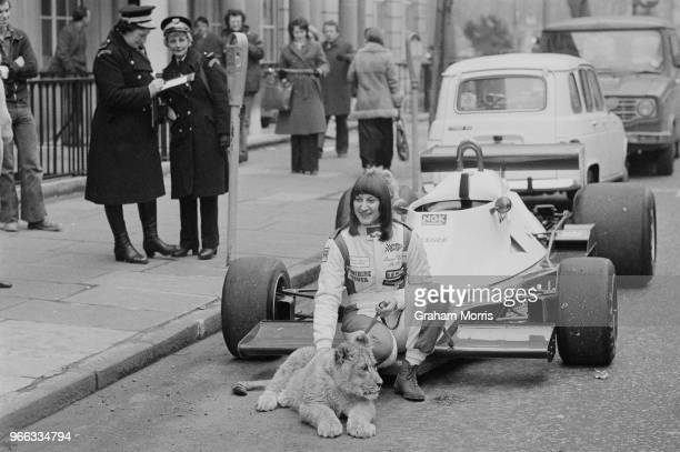 South African racing driver Desire Wilson with her new car a Melchester Tyrell 008 and a lion cub UK 19th February 1979
