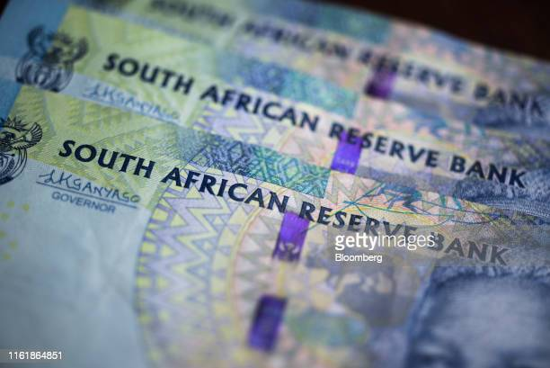 South African rand banknotes sit in this arranged photograph in Pretoria, South Africa, on Wednesday, Aug. 14, 2019. The rand ended a tumultuous week...