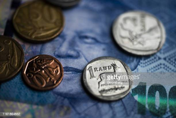 South African rand coins sit on a 100 South African rand banknote in this arranged photograph in Pretoria, South Africa, on Wednesday, Aug. 14, 2019....