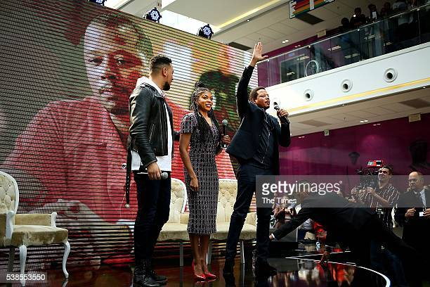 South African rapper AKA hosts Taraji P Henson and Terrence Howard on stage during the Empire cast South African tour at the Multichoice City...