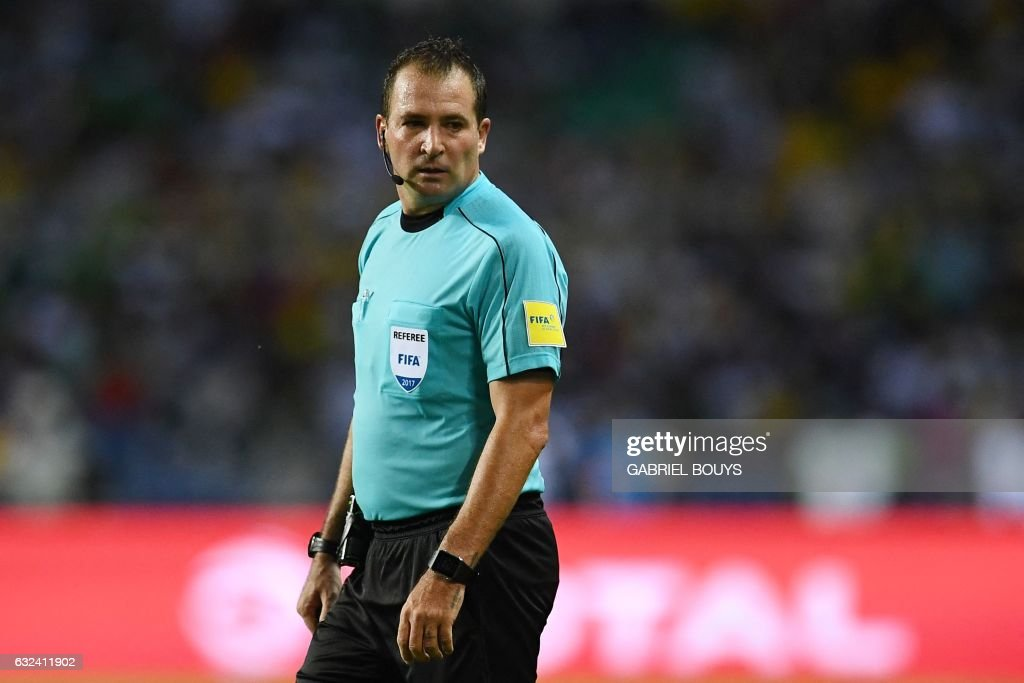 South African referee Daniel Bennett officiates the 2017 Africa Cup of Nations group A football match between Cameroon and Gabon at the Stade de l'Amitie Sino-Gabonaise in Libreville on January 22, 2017. /