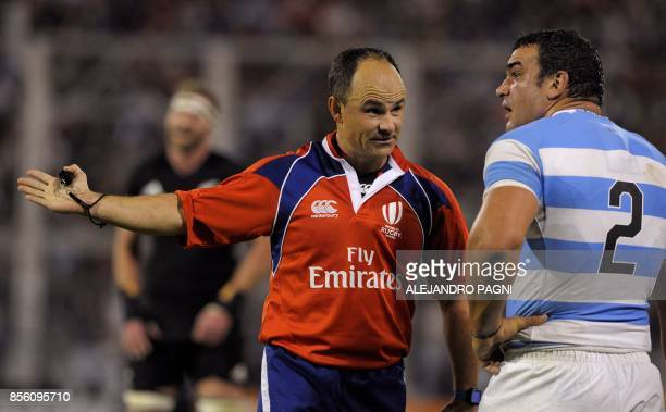 South African referee Jaco Peyper chats with Argentina's Los Pumas hooker Agustin Creevy during their Rugby Championship 2017 match against New...