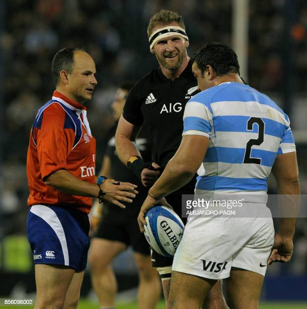 South African referee Jaco Peyper chats with Argentina's Los Pumas hooker Agustin Creevy and New zealand's All Blacks Kieran Read during their Rugby...