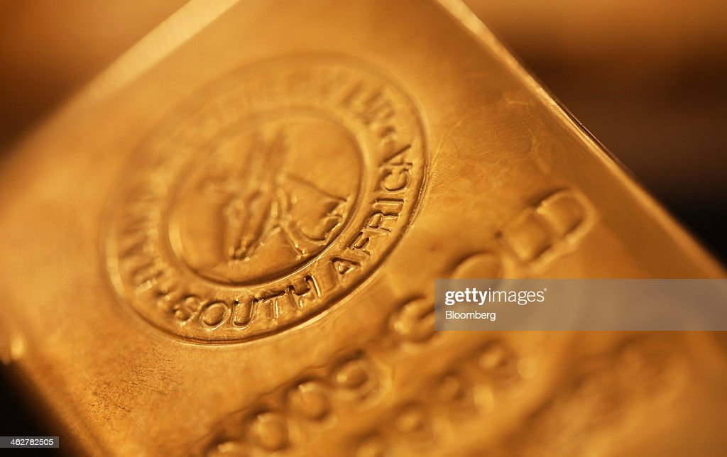 A South African refined one kilogram gold bar is seen in this arranged photograph at Gold Investments Ltd. bullion dealers in London, U.K., on Wednesday, Jan. 15, 2014. Gold futures extended a decline from a one-month high on speculation that the U.S. Federal Reserve will continue reducing stimulus, strengthening the dollar and cutting the metal's appeal as an alternative investment. Photographer: Chris Ratcliffe/Bloomberg via Getty Images