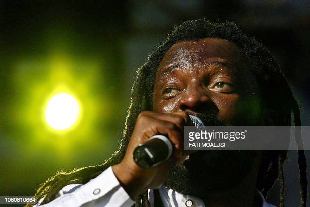 South African reggae singer Lucky Dube performs at the global call concert against poverty in Johannesburg South Africa 02 July 2005 Lucky Philip...
