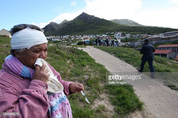 A South African resident of the informal township Hangberg reacts after violence broke out in Hout Bay near Cape Town South Africa on 21 September...