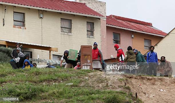 South African residents of the informal settlement Hangberg keep watch after violence broke out in Hout Bay near Cape Town South Africa on 21...