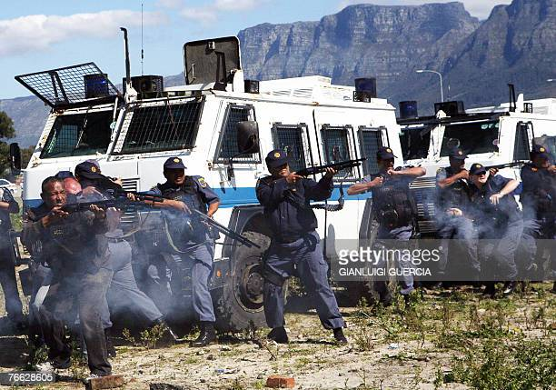 South African riot police fire rubber bullets and stone grenades 10 September 2007 at hundreds of residents of the Joe Slovo informal settlement...