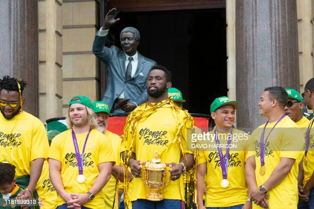 TOPSHOT South African Rugby captain Siya Kolisi holds the Web Ellis Trophy during the South African Rugby World Cup winner team's last stop to parade...