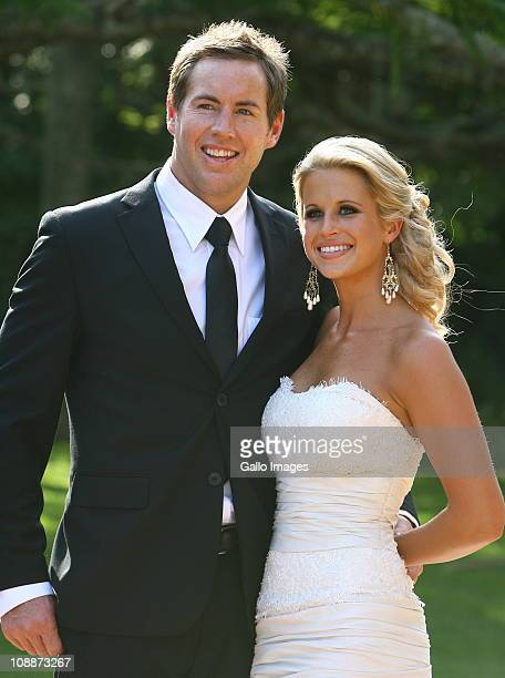 South African rugby player Andrew David Butch James poses with his bride Julia Westbrook during their wedding at Lynton Hall on 5 February 2011 in...