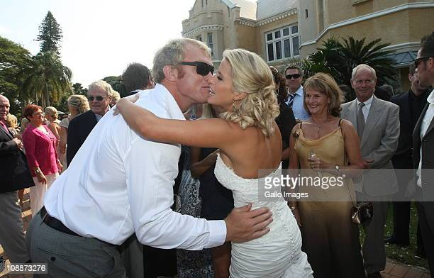 South African rugby player Schalk Burger kisses the bride at Butch James and Julia Westbrook's wedding at Lynton Hall on 5 February 2011 in...