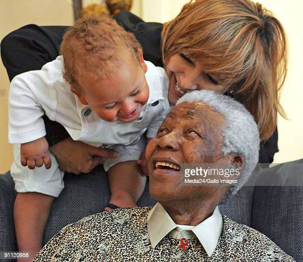 South African rugby playerChester Williams' wife Maria and baby sharing a moment with Nelson Mandela