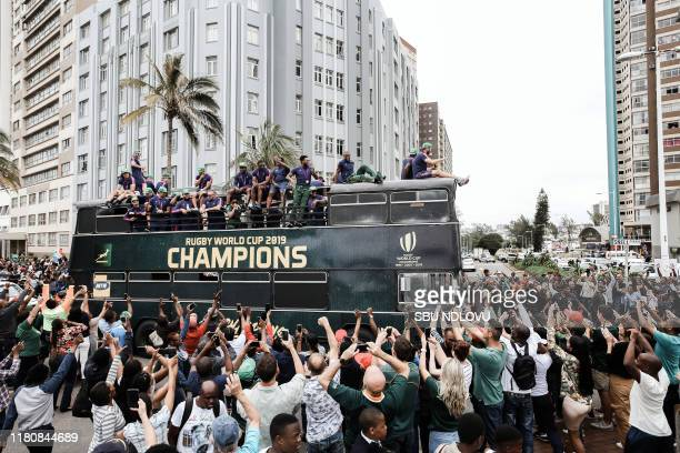 South African Rugby team players parade at the promenade at the North Beach in Durban on an open top bus during a trophy tour in which the Springboks...