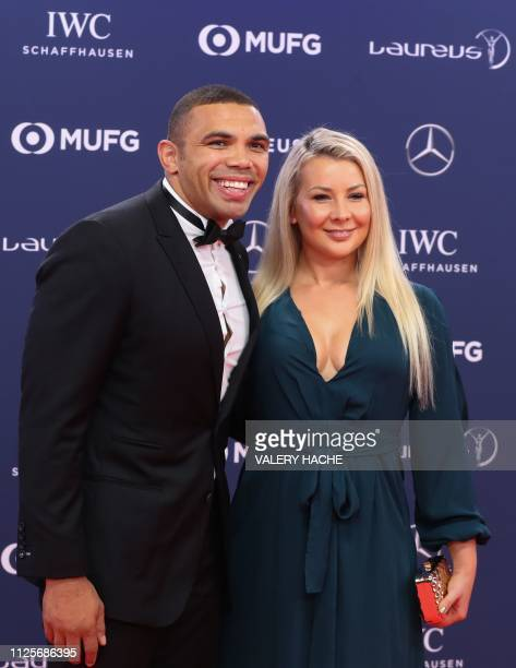 South African rugby union player Bryan Habana poses with his wife Janine Viljoen on the red carpet before the 2019 Laureus World Sports Awards...