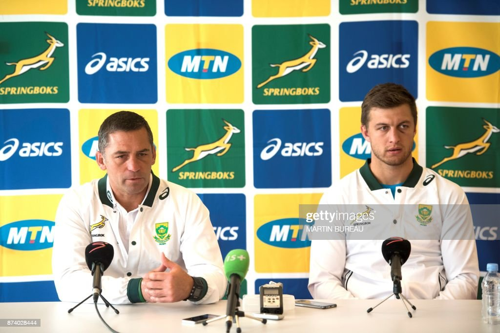 South African rugby union's head coach Franco Smith (L) and fly half Handre Pollard give a press conference at their hotel five days ahead there test match against France, on November 14, 2017 in Boulogne-Billancourt, western Paris. / AFP PHOTO / Martin BUREAU