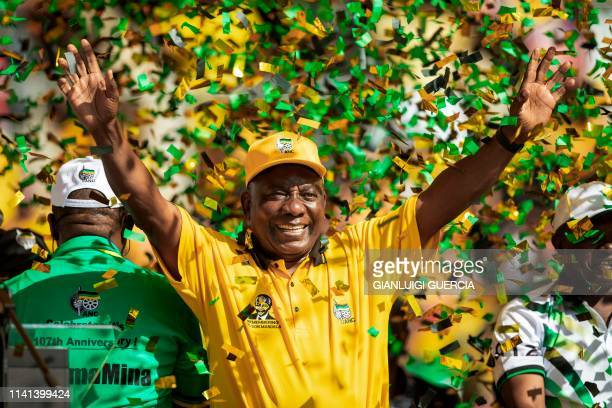 TOPSHOT South African ruling party African National Congress President and South Africa's President Cyril Ramaphosa waves at thousands of supporters...