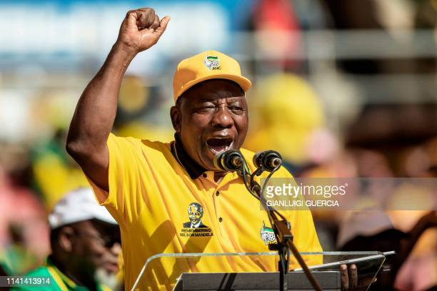 South African ruling party African National Congress President and South Africa's President Cyril Ramaphosa gestures as he delivers a speech on stage...