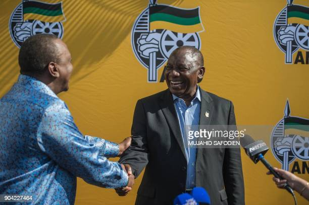 South African ruling party African National Congress President Cyril Ramaphosa and Kenya President Uhuru Kenyatta shake hands during a press briefing...