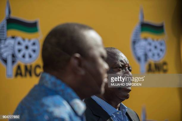South African ruling party African National Congress President Cyril Ramaphosa and Kenya President Uhuru Kenyatta look on during a press briefing on...