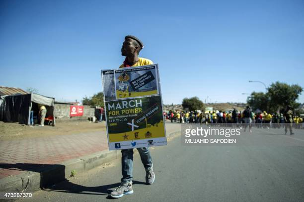 South African ruling party African National Congress supporters hold signs as they take part in a march against South African power supplier ESKOM...