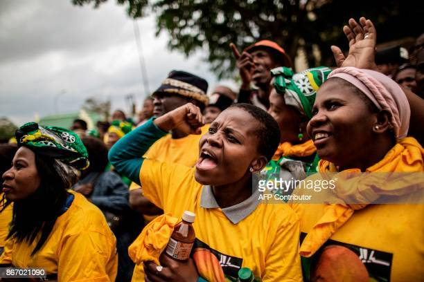 TOPSHOT South African ruling party African National Congress supporters celebrates the sentencing of two farm managers convicted of attempted murder...