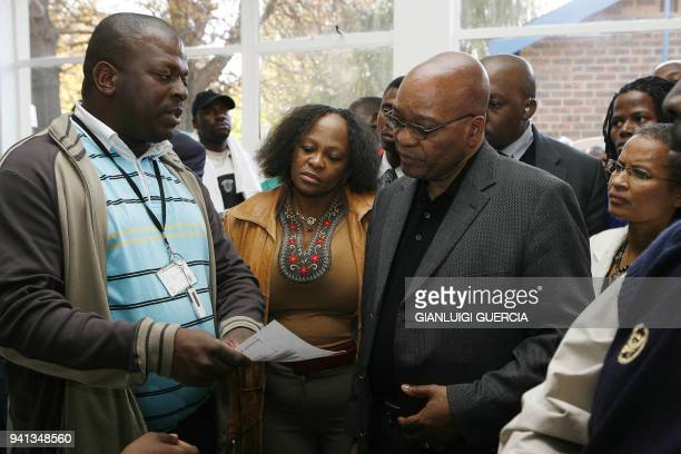 South African ruling party ANC president Jacob Zuma and antiapartheid campaigner Winnie Mandela visit on May 30 2008 an informal refugees camp for...