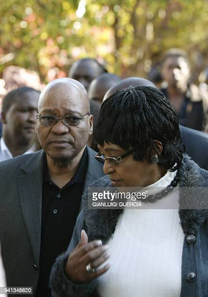South African ruling party ANC president Jacob Zuma and antiapartheid campaigner Winnie Mandela visit on May 30 2008 an informal refugee camp for...