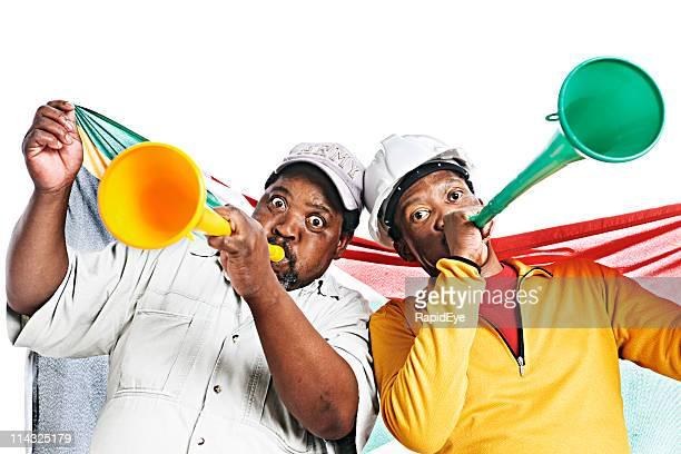 South African soccer fans blow vuvuzelas