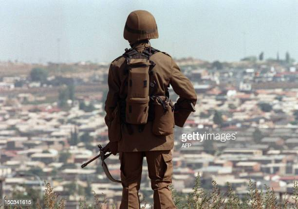 South African soldier keeps watch over Soweto during a campaign meeting of African National Congress leader Nelson Mandela 23 April 1994, three days...