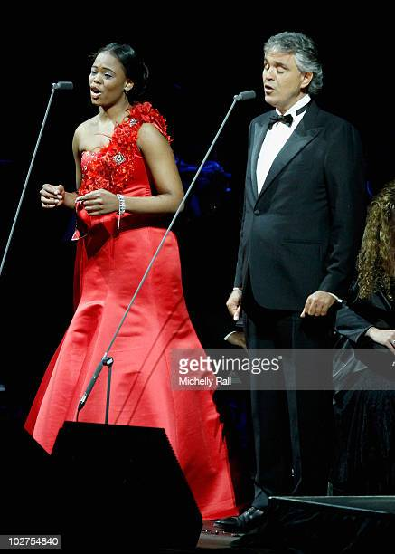South African soprano Pretty Yende and tenor Andrea Bocelli perform on stage during the Celebrate Africa The Grand Finale at the Coca Cola Dome on...