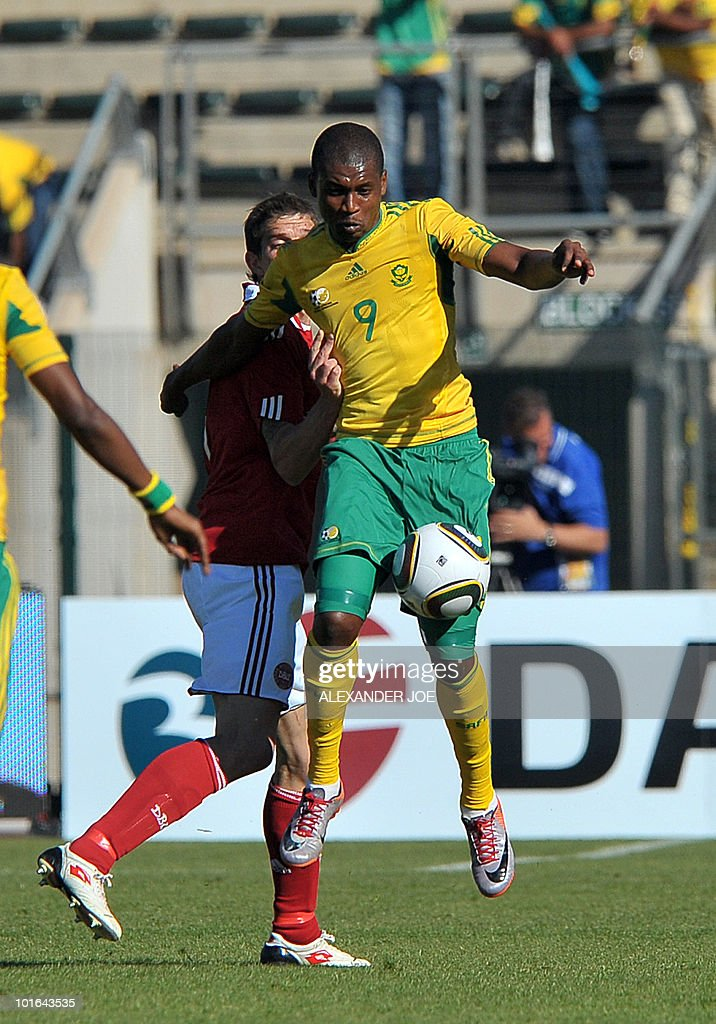 South African Striker Katlego Mphela vies for the ball with Denmarks Daniel Agger, during the friendly football match between South Africa and Denmark at Atteridgeville Super Stadium in Pretoria on June 5, 2010. The South African team won the match 1-0, prior to the FIFA 2010 World Cup in South Africa.