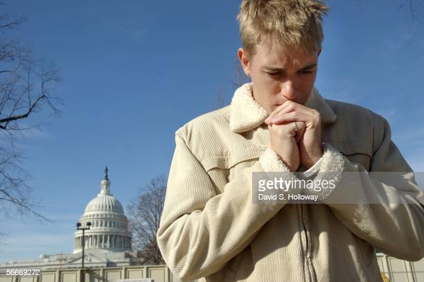 South African Student Deville Van Niekerk prays with other antiabortion activists during a March for Life prayer vigil in front of the Supreme court...