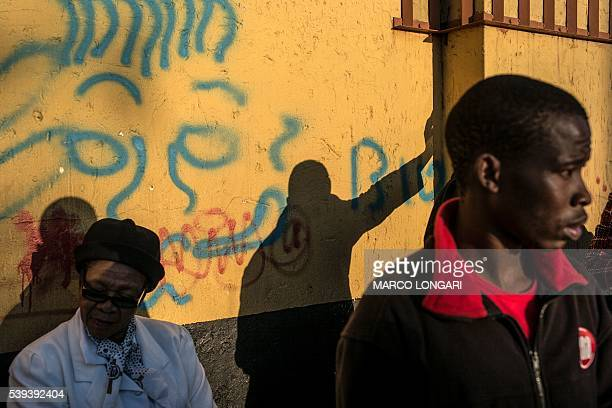 TOPSHOT South African students and other members of the public gather in Soweto on June 11 2016 at a march held to commemorate the 40th anniversary...