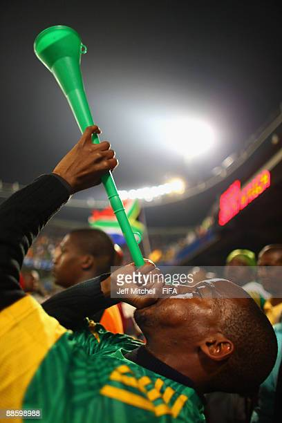 South African supporter blows a vuvuzela during the FIFA Confederations Cup match between Spain and South Africa at the Free State stadium on June...
