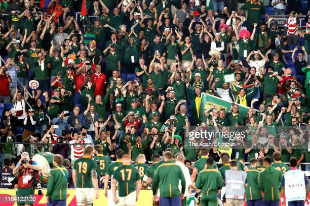 South African supporters celebrate their team's victory after the Rugby World Cup 2019 SemiFinal match between Wales and South Africa at...