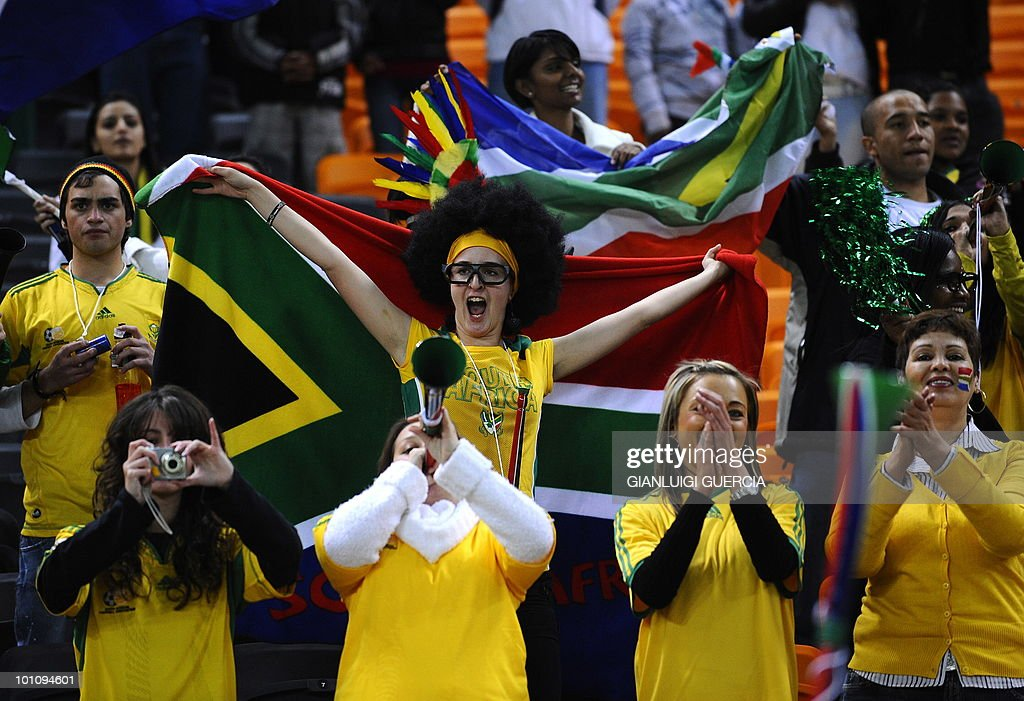 South African supporters cheer ahead of the international friendly football match between South Africa and Colombia at the Soccer City stadium in Soweto, Johannesburg on May 27, 2010. The 2010 FIFA World Cup football championship is due to take place in South Africa from June 11 to July 11 of 2010.
