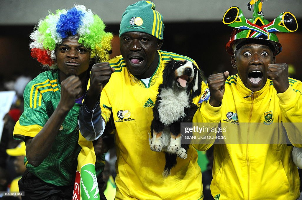 South African supporters pose as they cheer ahead of their international friendly football match against Bulgaria at the Orlando stadium in Soweto, Johannesburg. on May 24, 2010. The 2010 FIFA World Cup football championship is due to take place in South Africa from June 11 to July 11 of 2010.