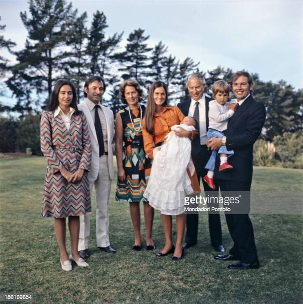 South African surgeon Christiaan Barnard and his wife Barbara Zoellner posing holding their children Frederik and Christiaan jr Plettenberg Bay 1977