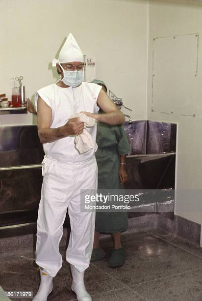 South African surgeon Christiaan Barnard cleaning up his hands with a tissue 1977