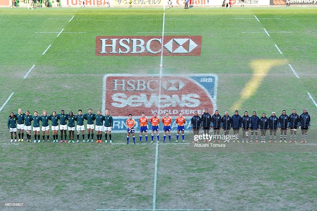 South African team (L) and Fiji team line up before the Cup Final game during the Tokyo Sevens, the six round of the HSBC Sevens World Series at the Prince Chichibu Memorial Ground on March 23, 2014 in Tokyo, Japan.