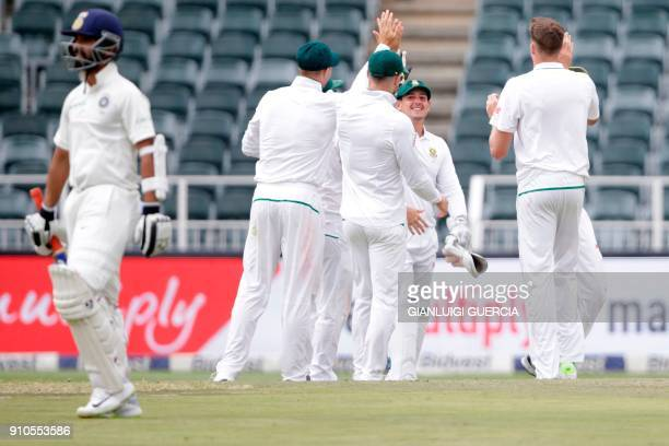 South African team celebrates the dismissal of Indian batsman Ajinkya Rahane during the third day of the third test match between South Africa and...