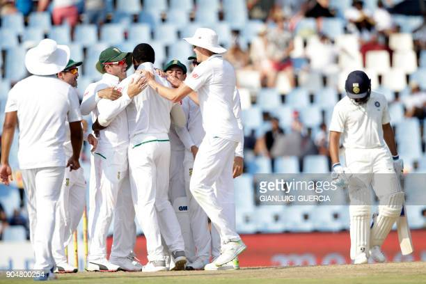 South African team celebrates the dismissal of Indian batsman Rohit Sharma during the second day of the second Test cricket match between South...